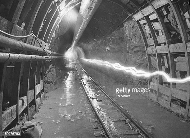 SEP 1 1964 SEP 25 1964 Ghost Path Forms in Loveland Pass Highway Tunnel Deep inside the pioneer bore for one of the highway tunnels which will some...