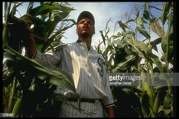 A ghost player in a vintage Chicago White Sox baseball uniform emerges from a cornfield as he reenacts the scene at the baseball field created for...