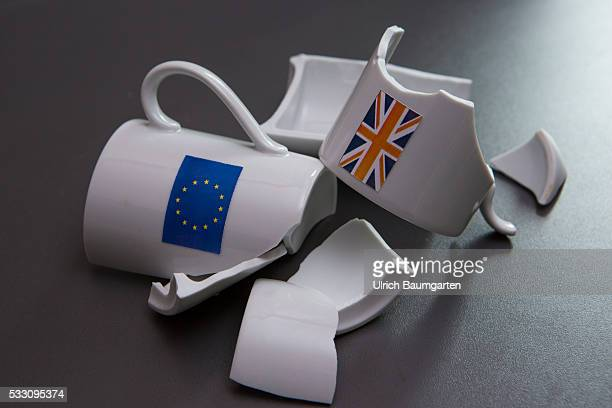 Ghost proposed referendum on United Kingdom membership of the European Union The photo shows a broken cup with the flags of the EU and Britain