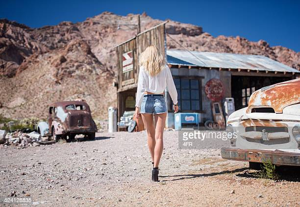 ghost town, woman at a gas station - hot pants stock photos and pictures