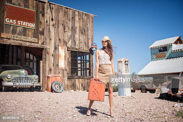 ghost town, woman at a gas station - hot legs stock photos and pictures