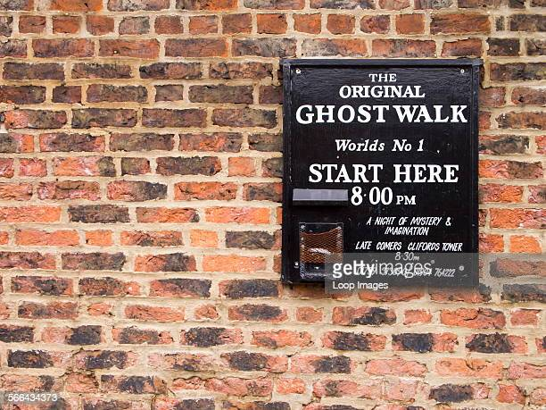 Ghost Walk starting point sign on a wall near the River Ouse.