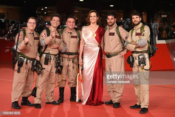 Ghostbusters cosplayers and Sigourney Weaver pose on the red carpet during the 13th Rome Film Fest at Auditorium Parco Della Musica on October 24,...