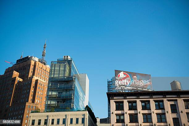 ghostbusters movie billboard in new york city - ghostbusters 2016 film stock pictures, royalty-free photos & images