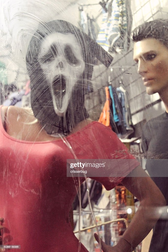 Ghostface 'Scream' Mask Behind Dirty Glass : Stock Photo