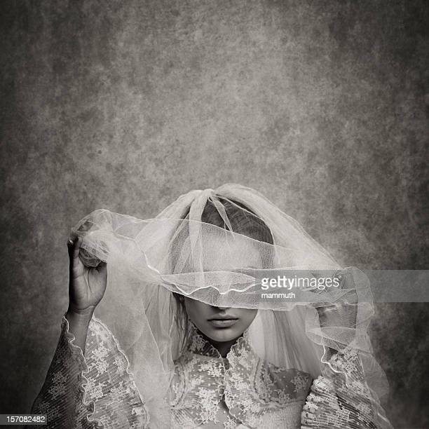ghostly bride raising her veil - veil stock photos and pictures
