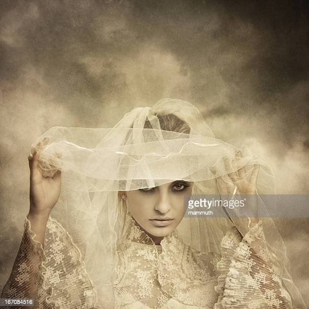 ghostly bride raising her veil