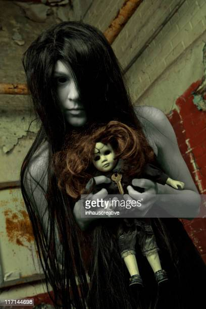 ghostly dead girl with creepy doll - ugly girl stock photos and pictures