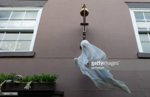 A ghostly shop decoration hangs above the shop doorway during Whitby Goth Weekend on October 27 2018 in Whitby England The Whitby Goth weekend began...
