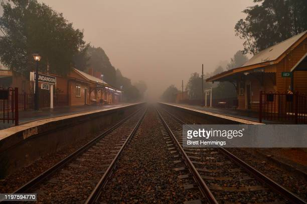 Ghostly train station is pictured as rain begins to fall on January 05, 2020 in Bundanoon, Australia. A state of emergency is in place across NSW as...
