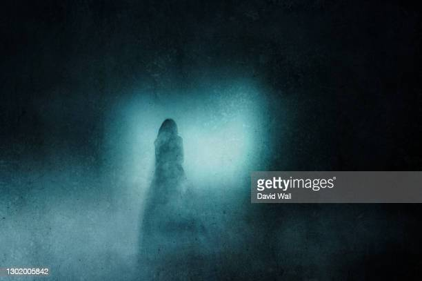 a ghostly transparent woman. standing in front of lights at night. with a grunge, blurred vintage edit. - women wearing see through clothing stock pictures, royalty-free photos & images