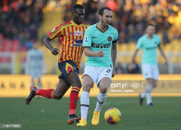 Ghouma Babacar of Lecce competes for the ball with Diego Godin of Inter during the Serie A match between US Lecce and FC Internazionale at Stadio Via...