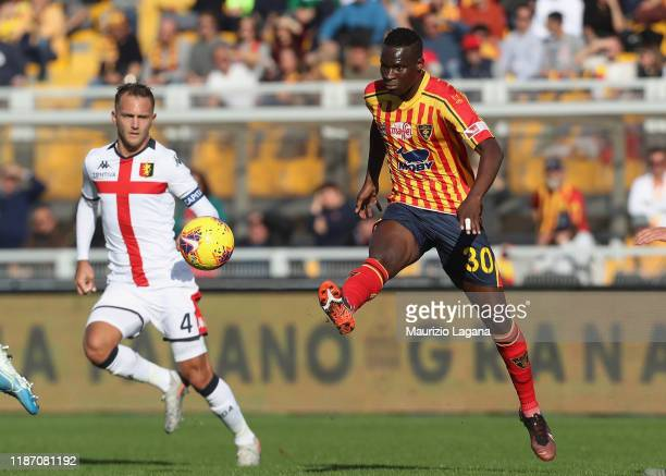 Ghouma Babacar of Lecce competes for the ball with Domenico Criscito of Genoa during the Serie A match between US Lecce and Genoa CFC at Stadio Via...