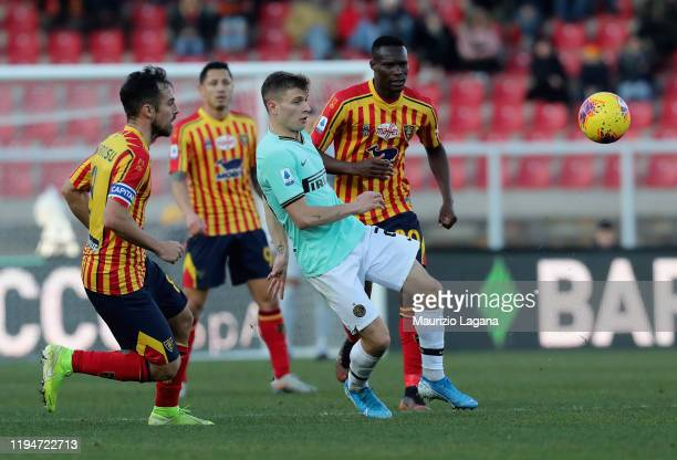 Ghouma Babacar of Lecce competes for the ball with Nicolò BArella of Inter during the Serie A match between US Lecce and FC Internazionale at Stadio...