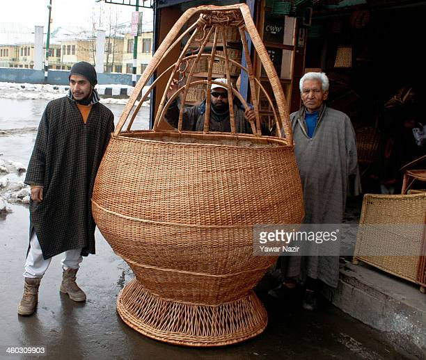 Ghulam Nabi Shaksaaz stands with the huge Kangri a traditional Kashmiri firepot that he made by hand on January 03 2014 in Srinagar the summer...