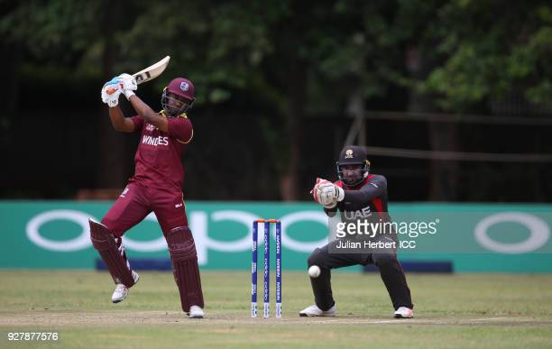 Ghulam Shabbir of THe UAE looks on as Evin Lewis of The West Indies scores run during The ICC Cricket World Cup Qualifier between The West Indies and...