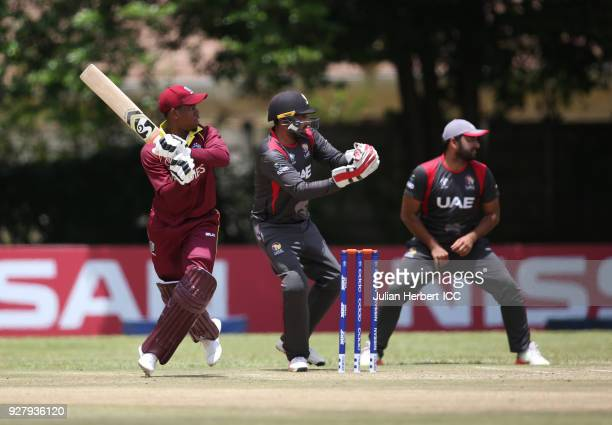 Ghulam Shabbir of The UAE looks on as Shimron Hetmyer of The West Indies hits out during The ICC Cricket World Cup Qualifier between The West Indies...