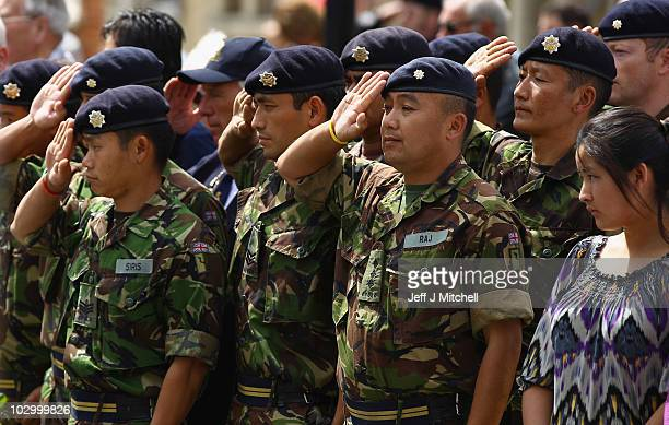 Ghurkhas salute in Wootton Bassett High Street as the cortege carrying the bodies of four soldiers killed in Afghanistan passes through on July 20,...