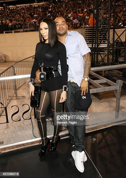 Gia Casey and DJ Envy attend D'USSE VIP Riser Lounge At On The Run Tour MetLife Stadium on July 12 2014 in East Rutherford City
