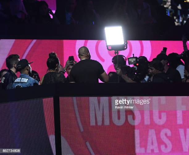 Gia Casey and DJ Envy attend the 2017 iHeartRadio Music Festival at TMobile Arena on September 23 2017 in Las Vegas Nevada