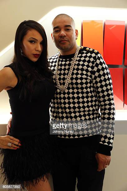 Gia Casey and DJ Envy celebrate DJ Envy's birthday at Ferrari Corporate Showroom on September 14 2016 in New York City