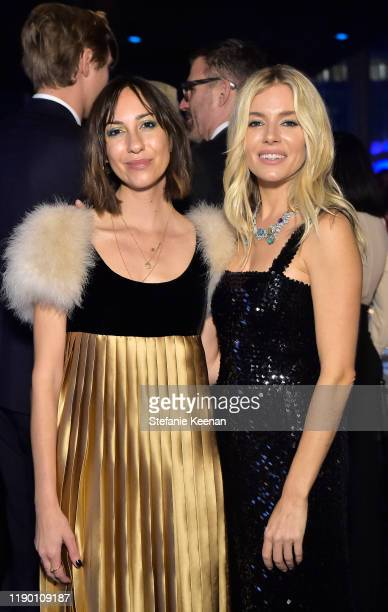 Gia Coppola and Sienna Miller both wearing Gucci attend the 2019 LACMA Art Film Gala Presented By Gucci at LACMA on November 02 2019 in Los Angeles...