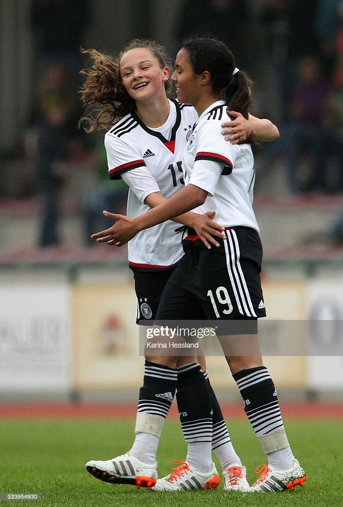 Gia Corley celebrates the fifth goal with Sanja Homann of Germany during the International Friendly match between U15 Girls Germany and U15 Girls Czech Republic at Auenstadion on May 24, 2016 in Floeha, Germany.