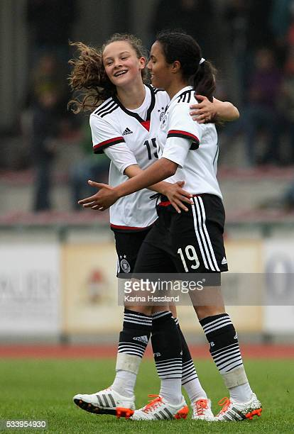 Gia Corley celebrates the fifth goal with Sanja Homann of Germany during the International Friendly match between U15 Girls Germany and U15 Girls...