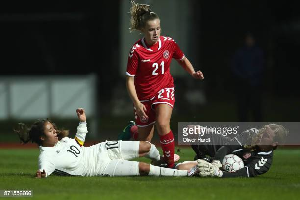 Gia Corley of Germany and Emilie Pruesse and Freja Thisgaard of Denmark compete for the ball during the U16 Girls international friendly match...