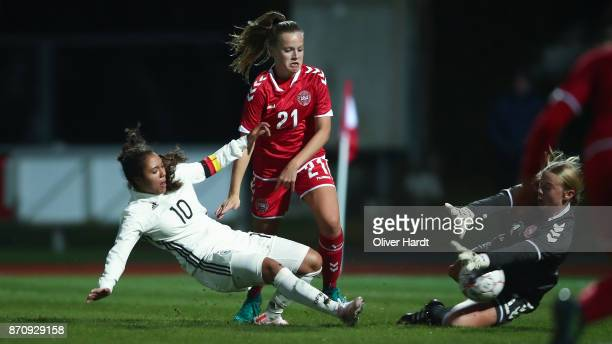 Gia Corley of Germany and Emilie Pruesse of Denmark compete for the ball during the U16 Girls international friendly match betwwen Denmark and...