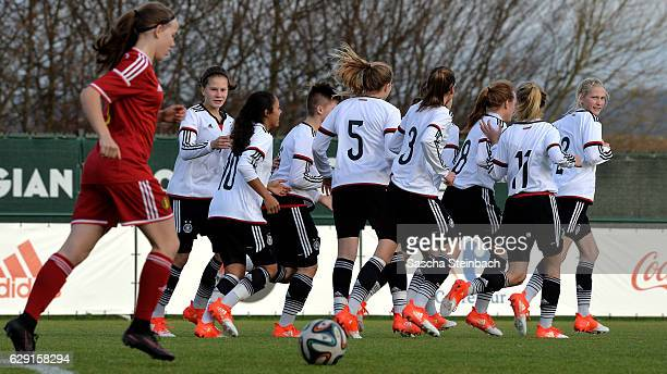 Gia Corley of Germany celebrates with team mates after scoring the opening goal during the U15 Girl's international friendly match between Belgium...