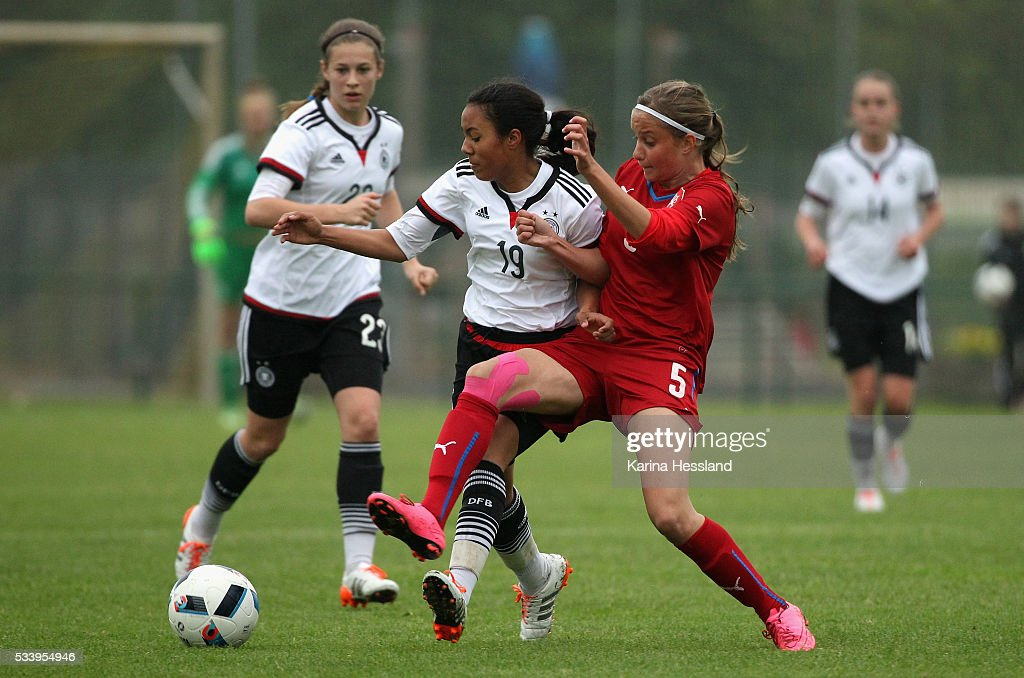 Gia Corley of Germany challenges Aneta Sovakova of Czech Republic during the International Friendly match between U15 Girls Germany and U15 Girls Czech Republic at Auenstadion on May 24, 2016 in Floeha, Germany.