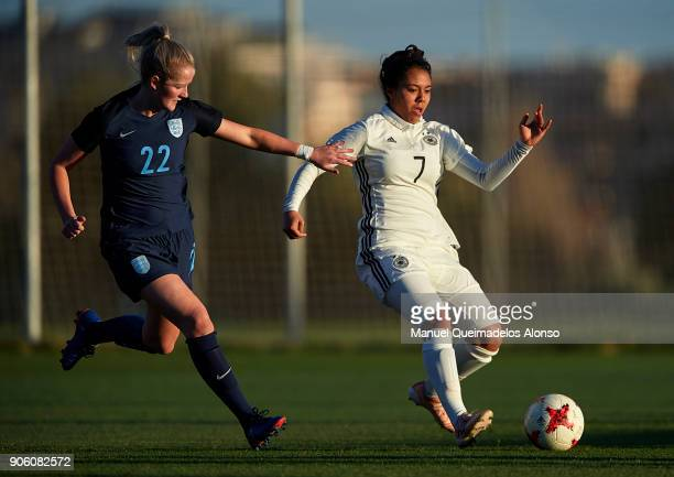 Gia Corley of Germany competes for the ball with Aimme Everett of England during the international friendly match between U17 Girl's Germany and U17...