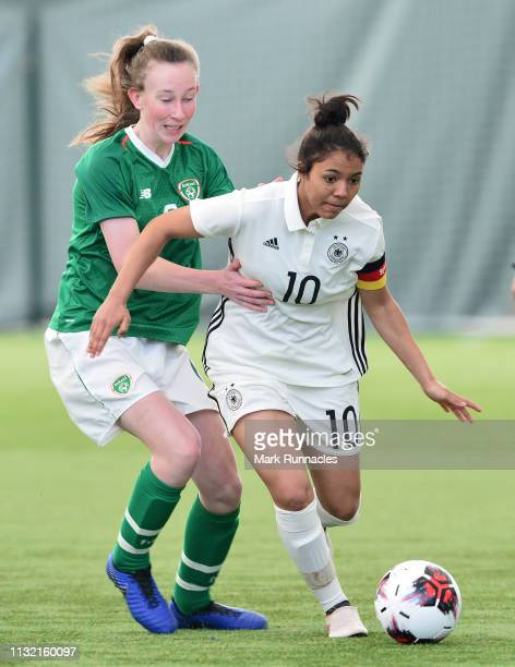 Gia Corley of Germany takes on Orla Prendergast of Ireland during the UEFA Elite Round match between Ireland U17 Girl's and Germany U17 Girl's at...