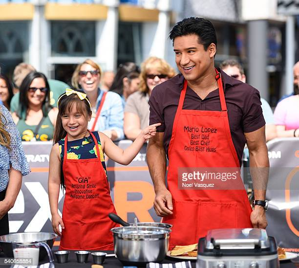 "Gia Francesca Lopez and Mario Lopez make waffles together at ""Extra"" at Universal Studios Hollywood on June 15, 2016 in Universal City, California."