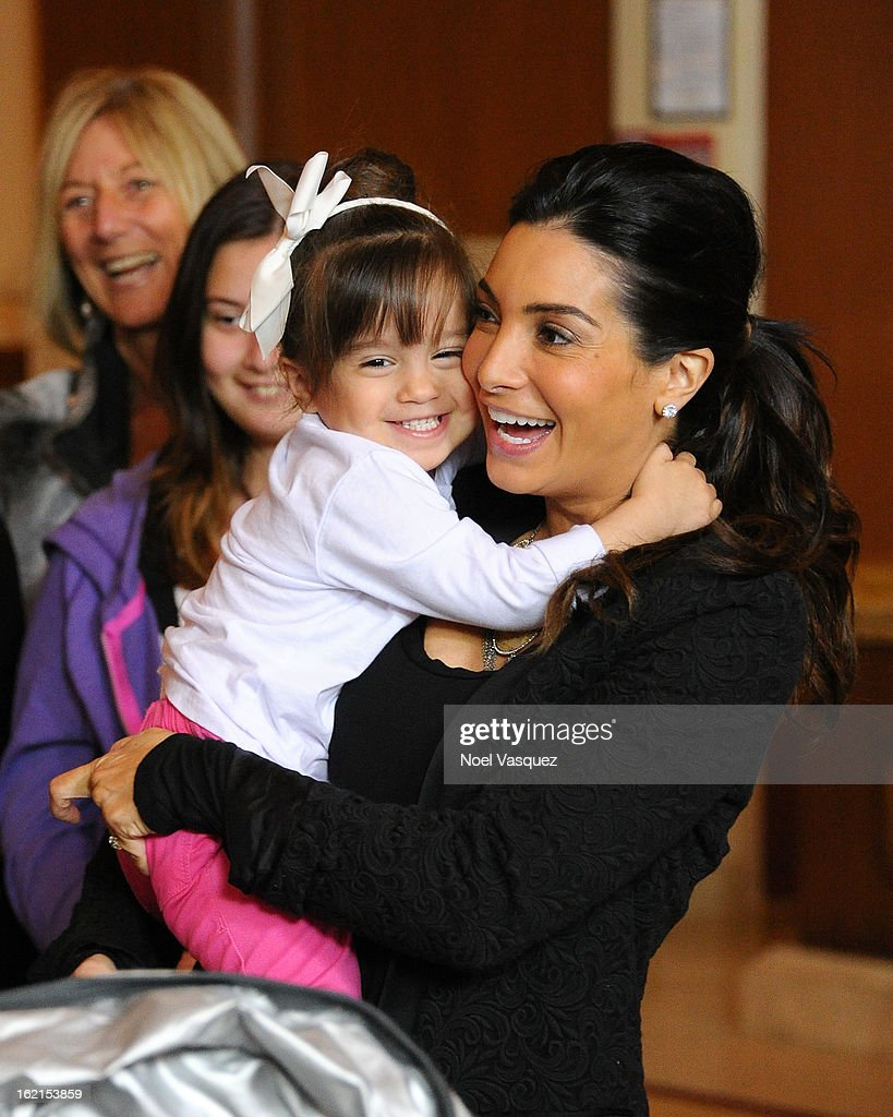 Gia Lopez (L) and Courtney Mazza Lopez announce their new baby at Extra at The Grove on February 19, 2013 in Los Angeles, California.