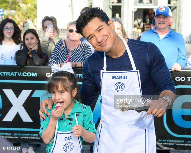 Gia Lopez and Mario Lopez visit 'Extra' at Universal Studios Hollywood on February 28 2017 in Universal City California