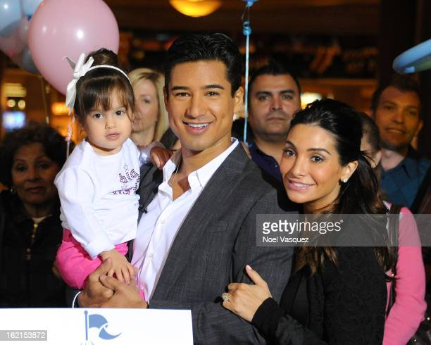 Gia Lopez Mario Lopez and Courtney Mazza Lopez announce his their new baby at Extra at The Grove on February 19 2013 in Los Angeles California