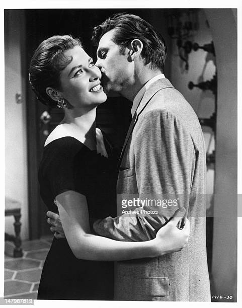 Gia Scala is kissed by Jack Lord in a scene from the film 'Tip On A Dead Jockey' 1957