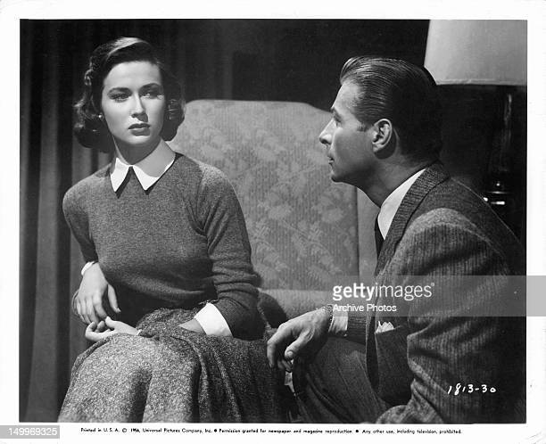 Gia Scala listening to Lex Barker in a scene from the film 'The Price Of Fear' 1956
