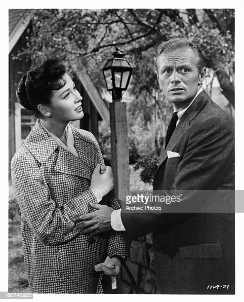 Gia Scala looking at concerned Richard Widmark in a scene from the film 'The Tunnel Of Love' 1958