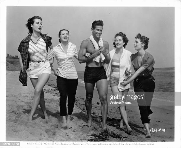 Gia Scala Marianne Koch George Nader Julie Adams and Elsa Martinelli walking down beach in publicity portrait the film 'Four Girls In Town' 1957