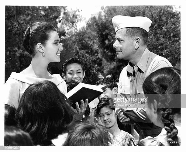 Gia Scala smiles her thanks to Glenn Ford in front of school children in a scene from the film 'Don't Go Near The Water' 1957