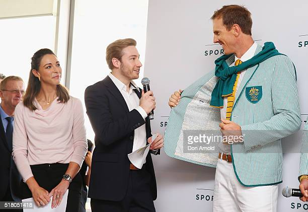 Giaan Rooney looks on as Matthew Mitcham talks to Ken Wallace during Sportscraft's 2016 Australian Olympic Team Opening Ceremony uniform launch on...