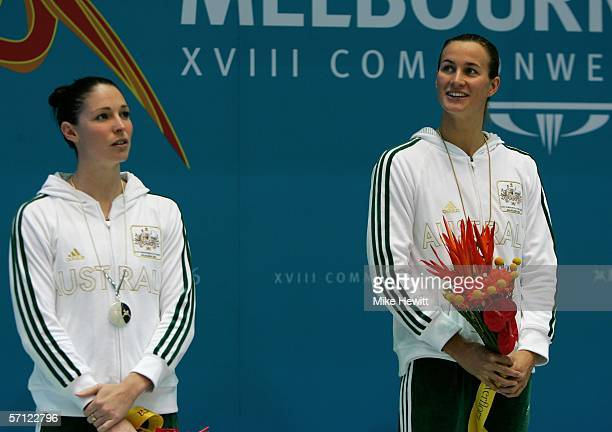 Giaan Rooney of Australia and Sophie Edington of Australia pose with their medals after the women's 100 metres backstroke final at the Melbourne...