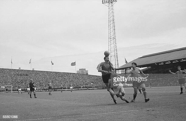 Giacinto Fachetti of Italy heads the ball clear from Igor Chislenko of the Soviet Union at Roker Park, Sunderland, during the 1966 World Cup...