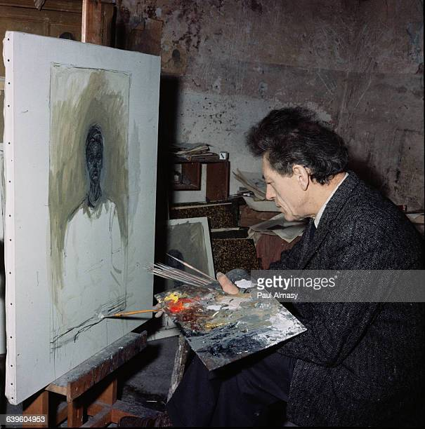 Giacometti at work on a painting in his studio 1958
