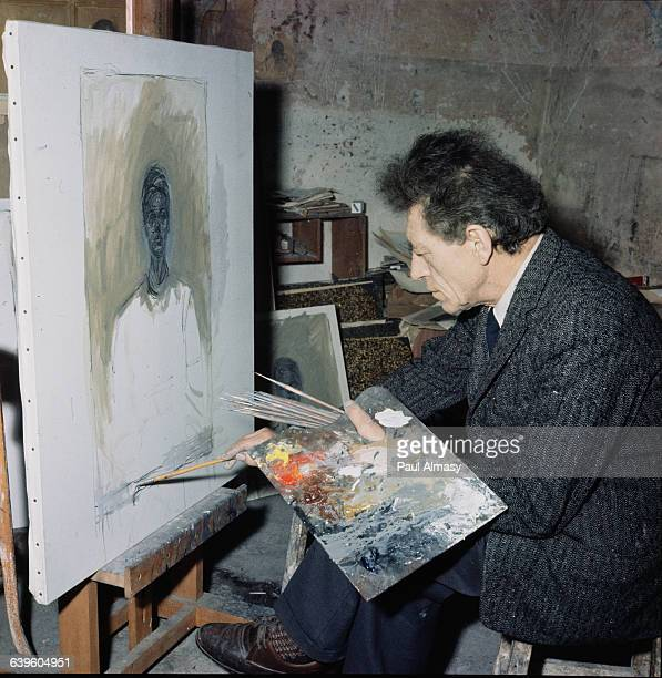 Giacometti at work on a painting in his studio France 1958