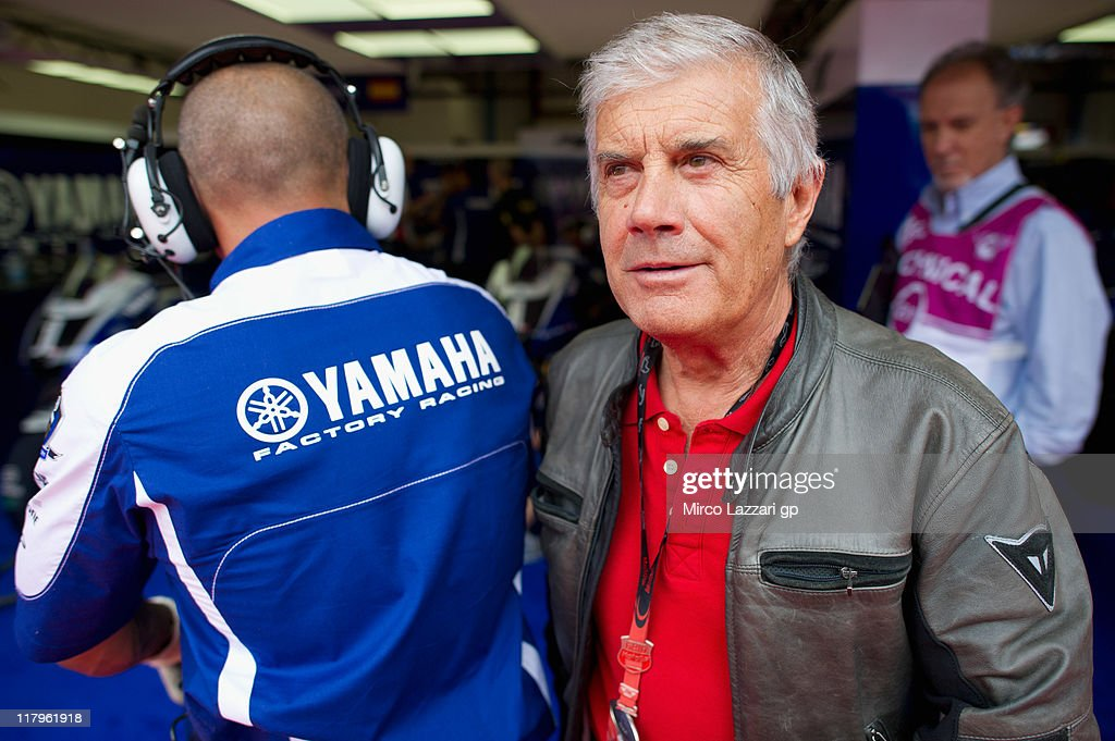 Giacomo Agostini of Italy looks on in front of box during the qualifying practice during the MotoGP of Italy at Mugello Circuit on July 2, 2011 in Scarperia near Florence, Italy.