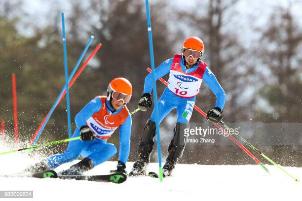 Giacomo Bertagnolli of Italy and his guide Fabrizio Casal competes in the Men's Slalom Run 2 Visually Impaired at Alpine Centre during day eight of...